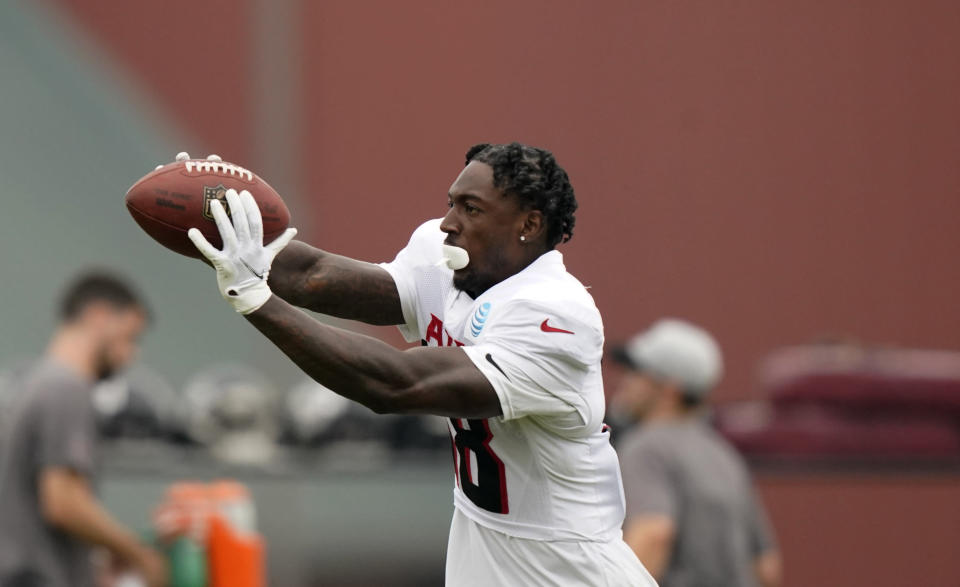 Atlanta Falcons wide receiver Calvin Ridley (18) catches the ball as he runs drills during NFL football practice on Tuesday, Aug. 3, 2021, in Flowery Branch, Ga. (AP Photo/Brynn Anderson)