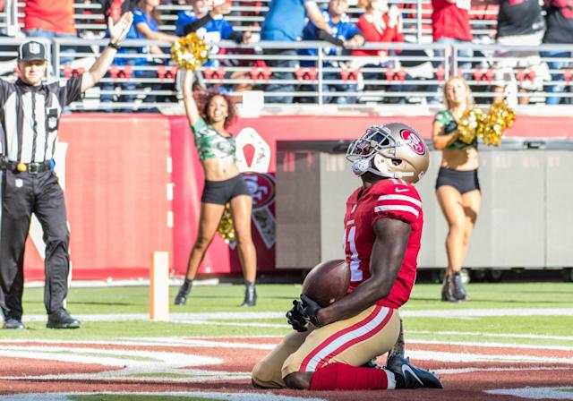 Marquis Goodwin went to his knees after his 83-yard touchdown reception. (Icon Sportswire via Getty Images)
