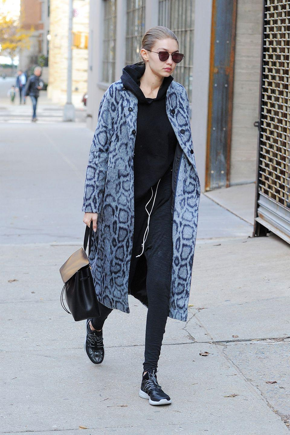 <p>In a grey leopard coat, black hoodie, sweatpants, Reebok sneakers, a Mansur Gavriel bag and dark, Gentle Monster wire-rimmed sunglasses while out in New York.</p>