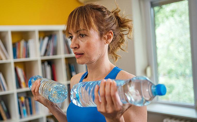 Workout at home using household items.