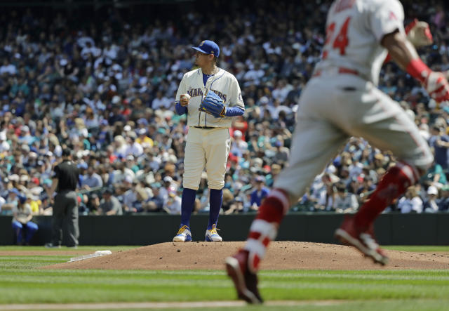 Seattle Mariners starting pitcher Felix Hernandez stands on the mound as Los Angeles Angels' Chris Young rounds the bases after hitting a solo home run in the second inning of a baseball game, Sunday, May 6, 2018, in Seattle. (AP Photo/Ted S. Warren)