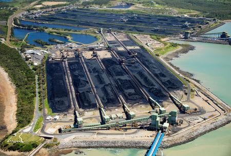 FILE PHOTO: Coal sits at the Hay Point and Dalrymple Bay Coal Terminals that receive coal along the Goonyella rail system, that services coal mines in the Bowen Basin, located south of the Queensland town of Mackay in Australia, April 11, 2017.   REUTERS/Daryl Wright/File Photo
