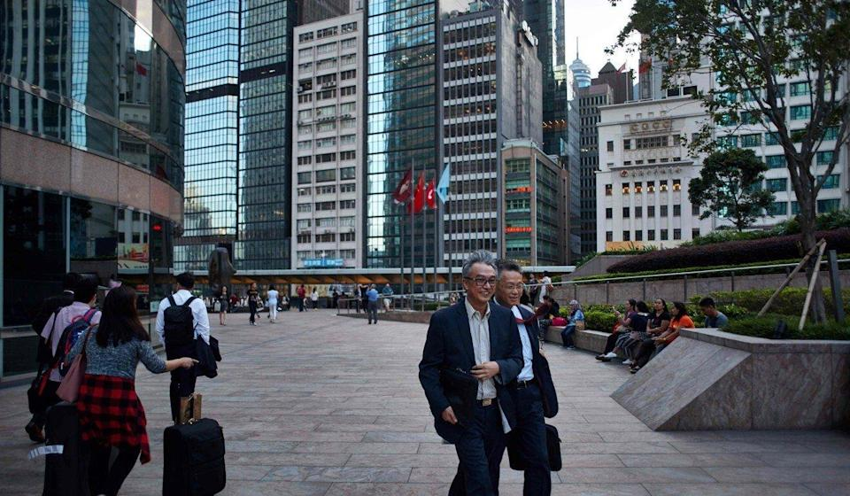 A photo from October 2017 shows pedestrians walking outside the Three Exchange Square building (left), which houses the Hong Kong stock exchange. Photo: AFP