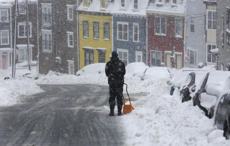 Blair Agnew shovels Wednesday, Feb. 15 in St. John's, Nfld. Schools and businesses were closed as blizzard conditions continue over the Avalon Peninsula. Photo from the Canadian Press.