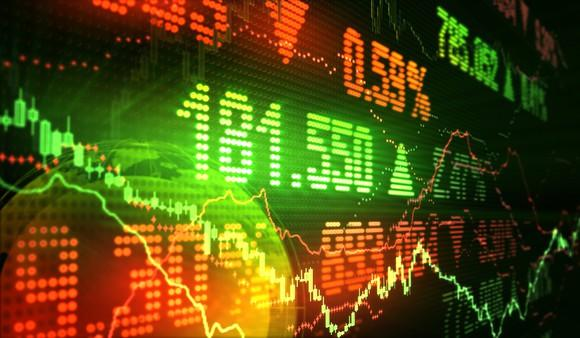 Stock market prices in green and red on an LED display