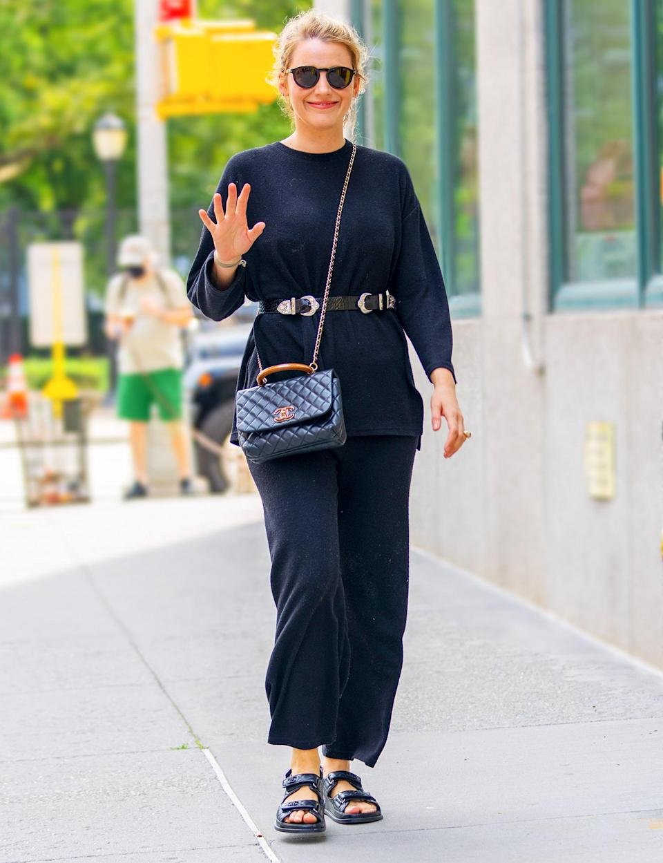<p>Blake Lively waves hello as she takes a stroll through N.Y.C. on July 15.</p>
