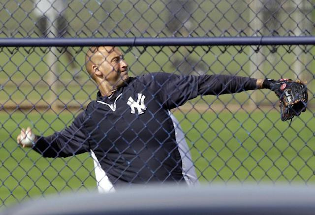 New York Yankees shortstop Derek Jeter throws during practice at the baseball team's minor league facility Thursday, Feb. 13, 2014, in Tampa, Fla. (AP Photo/Chris O'Meara)
