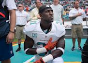 Miami Dolphins Safety Michael Thomas kneels during National Anthem at the game between the Cleveland Browns and the Miami Dolphins at Hard Rock Stadium in Miami Gardens, Fla. (Photo by Michele Eve Sandberg/Icon Sportswire via Getty Images)
