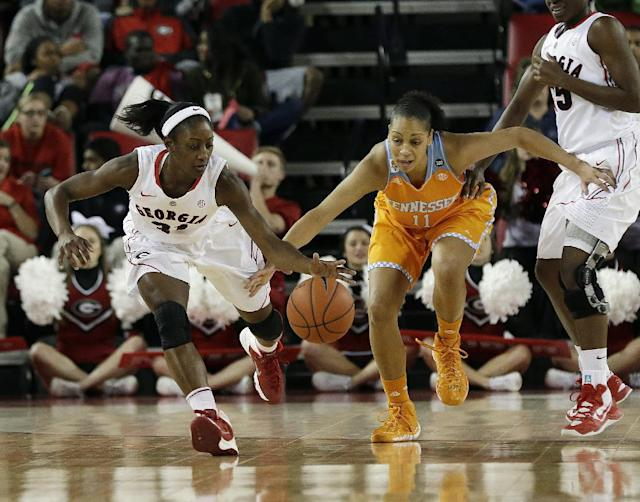 Georgia guard Erika Ford, left, and Tennessee forward Cierra Burdick (11) chase down a loose ball in the first half of an NCAA college basketball game Sunday, Jan. 5, 2014, in Athens, Ga. Tennessee won 85-70. (AP Photo/John Bazemore)
