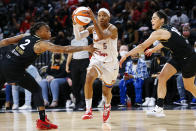 Phoenix Mercury guard Shey Peddy (5) drives to the basket between Las Vegas Aces guards Riquna Williams (2) and Kelsey Plum (10) during the first half of Game 5 of a WNBA basketball playoff series Friday, Oct. 8, 2021, in Las Vegas. (AP Photo/Chase Stevens)