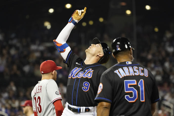 New York Mets' Brandon Nimmo (9) gestures after hitting a single during the fourth inning of a baseball game against the Philadelphia Phillies, Friday, Sept. 17, 2021, in New York. (AP Photo/Mary Altaffer)