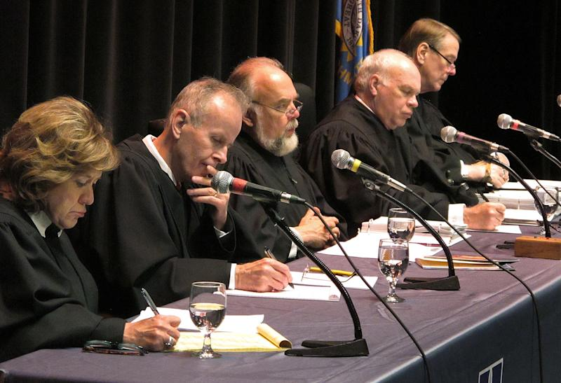 Hon. Kathleen Caldwell (left to right) and members of the South Dakota Supreme Court, John Konenkamp, Chief Justice David Gilbertson, Glen Severson and Steven Zinter listen during a hearing on Wednesday, Oct. 3, 2012 at the Jeschke Fine Arts Center at the University of South Dakota in SIoux Falls, S.D. (AP Photo/Argus Leader, Jay Pickthorn)