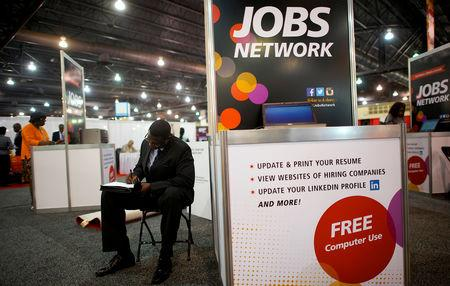FILE PHOTO: A job-seeker completes an application at a career fair in Philadelphia