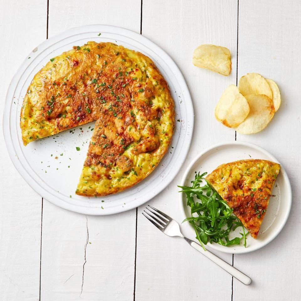 """<p>Yepp, there are crushed potato chips (use them in a pinch if you don't have potatoes!) stirred right into the omelet batter for extra heft that dad will eat right up.</p><p><em><a href=""""https://www.goodhousekeeping.com/food-recipes/a37302/potato-chip-omelet-recipe/"""" rel=""""nofollow noopener"""" target=""""_blank"""" data-ylk=""""slk:Get the recipe for Potato Chip Omelet »"""" class=""""link rapid-noclick-resp"""">Get the recipe for Potato Chip Omelet »</a></em></p>"""