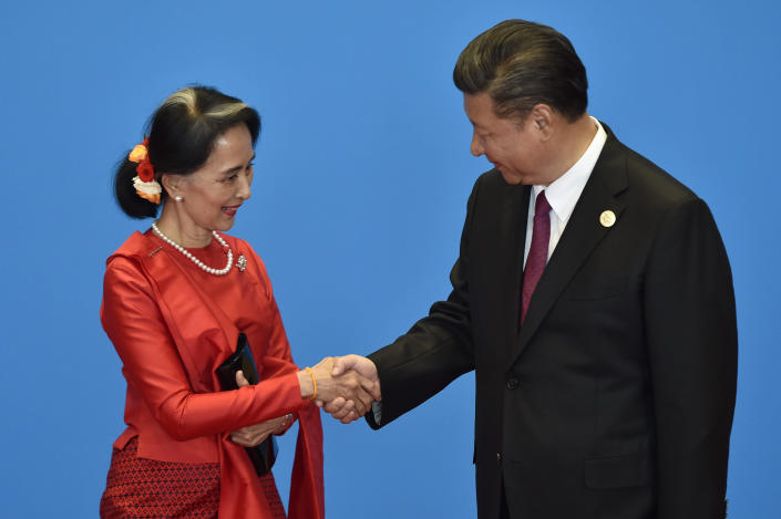 Myanmar State Counsellor Aung San Suu Kyi, left, shakes hands with Chinese President Xi Jinping during the welcome ceremony for the Belt and Road Forum at the International Conference Center in Yanqi Lake, north of Beijing, on May 15, 2017. (Photo: Kenzaburo Fukuhara/KYODONEWS/POOL)