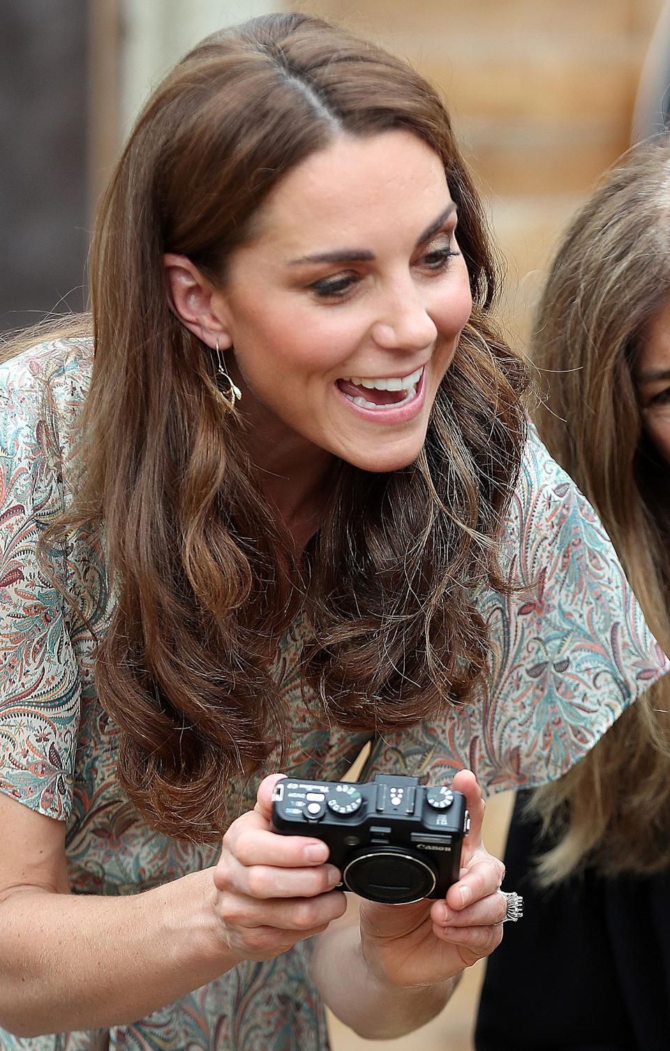Britain's Catherine, Duchess of Cambridge holds a camera as she takes part in a a photography workshop with the charity 'Action for Children' in Kingston, southwest London on June 25, 2019. (Photo by Chris Jackson / POOL / AFP)        (Photo credit should read CHRIS JACKSON/AFP via Getty Images)