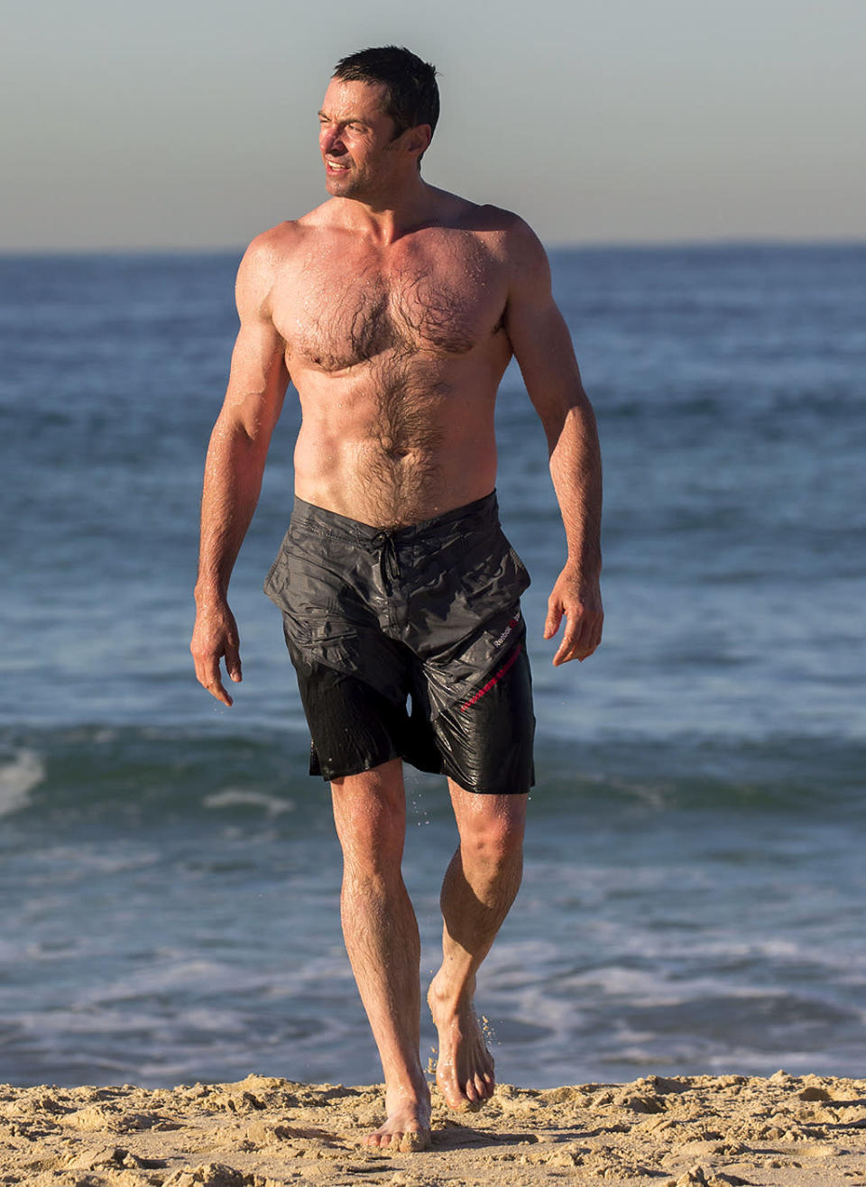 <p>It appears that the movie star, pictured in Sydney, took his <i>Wolverine 3</i> training very, very seriously. (Photo: Splash News) </p>