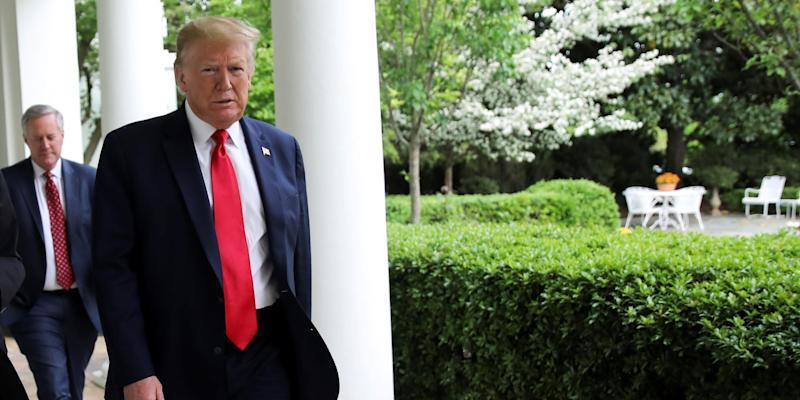 FILE PHOTO: U.S. President Donald Trump walks down the West Wing colonnade to the Oval Office before an interview about China, the novel coronavirus (COVID-19) pandemic and other subjects at the White House in Washington, U.S., April 29, 2020. REUTERS/Carlos Barria
