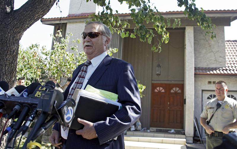 Attorney Steve Seiden speaks to reporters outside at a home believed to belong to the filmmaker associated with an anti-Muslim film, that has caused controversy and violence throughout the Middle East and elsewhere, in the Los Angeles suburb of Cerritos, Calif., Friday, Sept. 14, 2012. The crudely crafted film that ridicules Muslims and the prophet Muhammad has incited violent protests across the Middle East. (AP Photo/Reed Saxon)