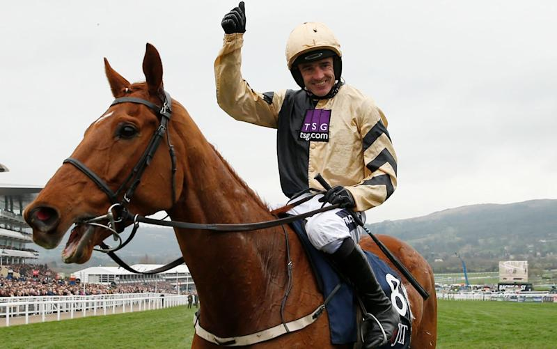 Ruby Walsh celebrates after winning the JLT Novices™' Chase on Yorkhill - -