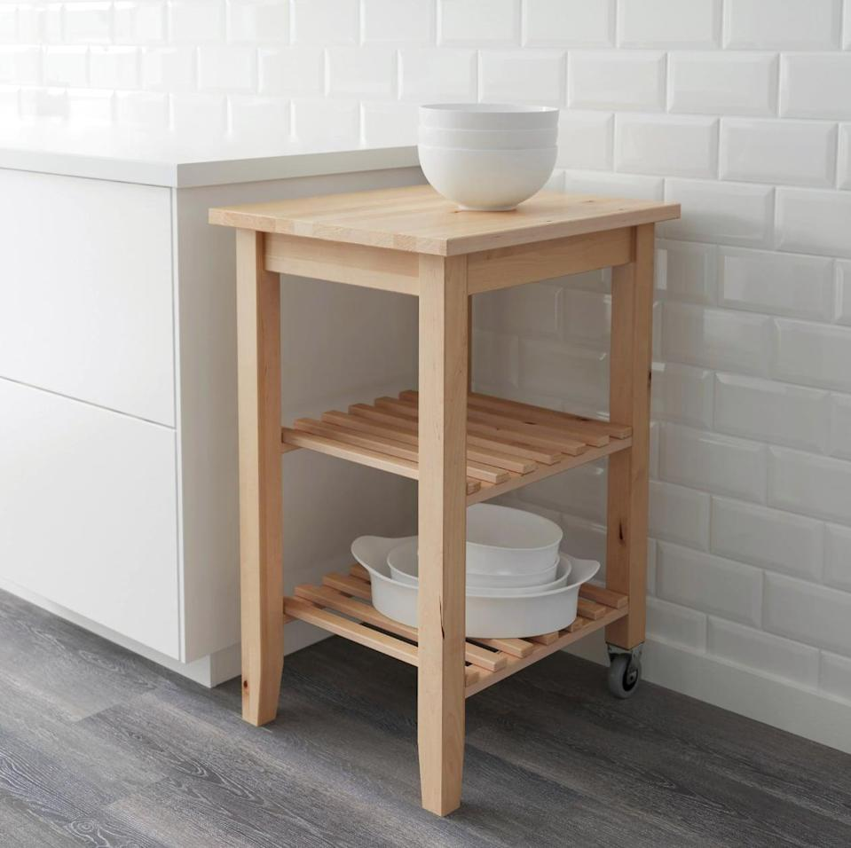 "<p>Store the <a href=""https://www.popsugar.com/buy/Bekv%C3%A4m%20Kitchen%20Cart-447000?p_name=Bekv%C3%A4m%20Kitchen%20Cart&retailer=ikea.com&price=60&evar1=casa%3Aus&evar9=46151613&evar98=https%3A%2F%2Fwww.popsugar.com%2Fhome%2Fphoto-gallery%2F46151613%2Fimage%2F46152189%2FBekv%C3%A4m-Kitchen-Cart&list1=shopping%2Cikea%2Corganization%2Ckitchens%2Chome%20shopping&prop13=api&pdata=1"" rel=""nofollow noopener"" target=""_blank"" data-ylk=""slk:Bekväm Kitchen Cart"" class=""link rapid-noclick-resp"">Bekväm Kitchen Cart</a> ($60) in a kitchen nook and keep pots, plates, dishes, and pans in easy reach.</p>"