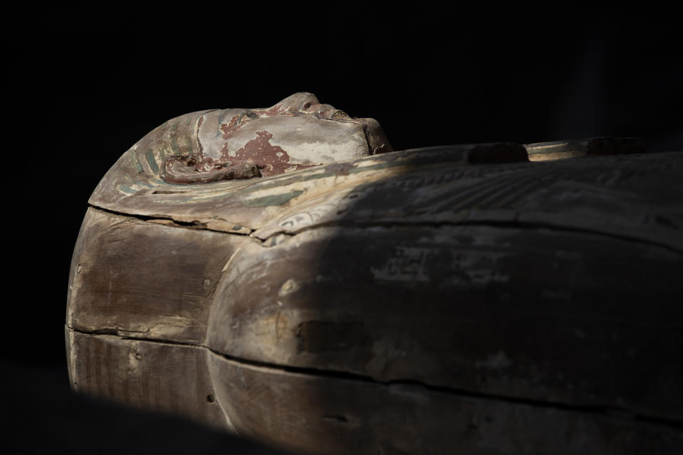 A sarcophagus that is around 2500 years old is shown at the Saqqara archaeological site, 30 kilometers (19 miles) south of Cairo, Egypt, Saturday, Oct. 3, 2020. Egypt says archaeologists have unearthed about 60 ancient coffins in a vast necropolis south of Cairo. The Egyptian Tourism and Antiquities Minister says at least 59 sealed sarcophagi with mummies inside were found that had been buried in three wells more than 2,600 years ago. (AP Photo/Mahmoud Khaled)