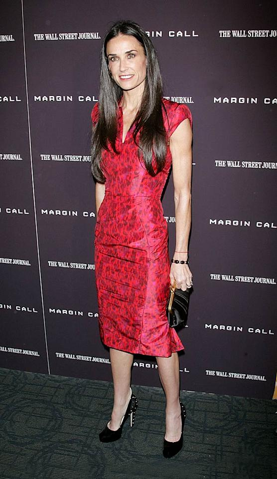 "Demi Moore looked ferocious in an animal print Zac Posen dress and studded Brian Atwood pumps at the New York City premiere of her upcoming thriller, ""Margin Call."" Ashton, eat your heart out! (10/17/11)"