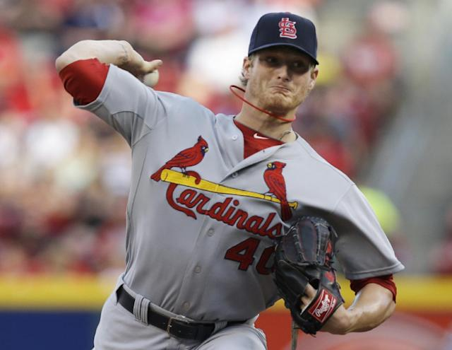 St. Louis Cardinals starting pitcher Shelby Miller throws against the Cincinnati Reds in the first inning of a baseball game, Friday, May 23, 2014, in Cincinnati. (AP Photo/Al Behrman)