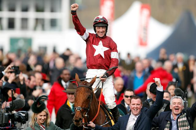 Horse Racing - Cheltenham Festival - Cheltenham Racecourse, Cheltenham, Britain - March 15, 2018 Davy Russell celebrates on Balko Des Flos after winning the 14:50 Ryanair Chase Action Images via Reuters/Matthew Childs