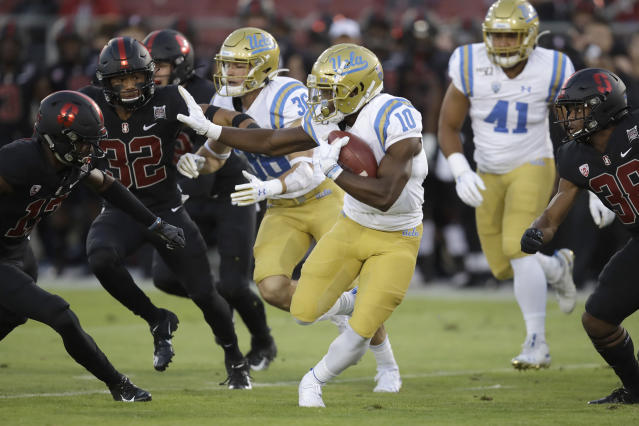UCLA's Demetric Felton (10) carries against Stanford during the first half of an NCAA college football game Thursday, Oct. 17, 2019, in Stanford, Calif. (AP Photo/Ben Margot)
