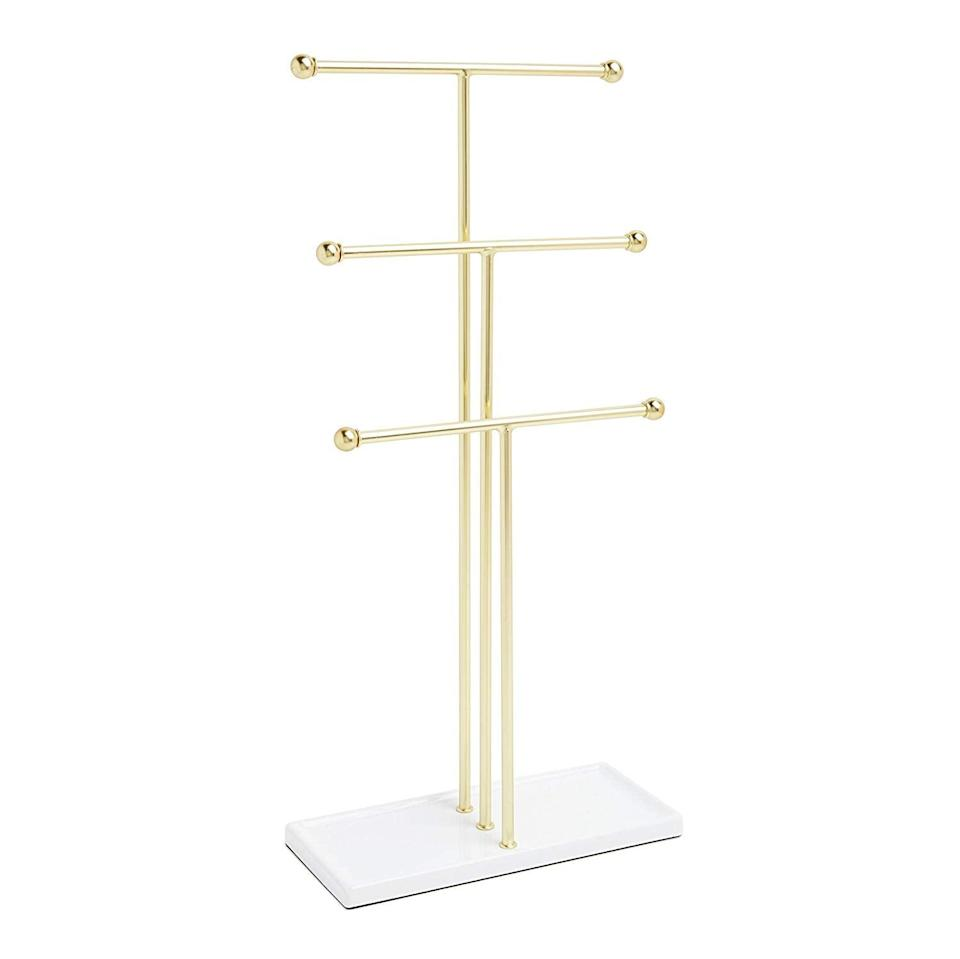 "<p>If you're a fan of ""all gold everything,"" the <a href=""https://www.popsugar.com/buy/Umbra-Trigem-Hanging-Organizer-410866?p_name=Umbra%20Trigem%20Hanging%20Organizer&retailer=amazon.com&pid=410866&price=20&evar1=casa%3Aus&evar9=45752594&evar98=https%3A%2F%2Fwww.popsugar.com%2Fhome%2Fphoto-gallery%2F45752594%2Fimage%2F45753876%2FThose-Too-Many-Necklaces&list1=amazon%2Caccessories%2Corganization%2Cstorage%20tips%2Chome%20organization&prop13=mobile&pdata=1"" class=""link rapid-noclick-resp"" rel=""nofollow noopener"" target=""_blank"" data-ylk=""slk:Umbra Trigem Hanging Organizer"">Umbra Trigem Hanging Organizer</a> ($20) might be for you. With three ramped rods, you can easily store anything from bracelets to longer necklaces. </p>"
