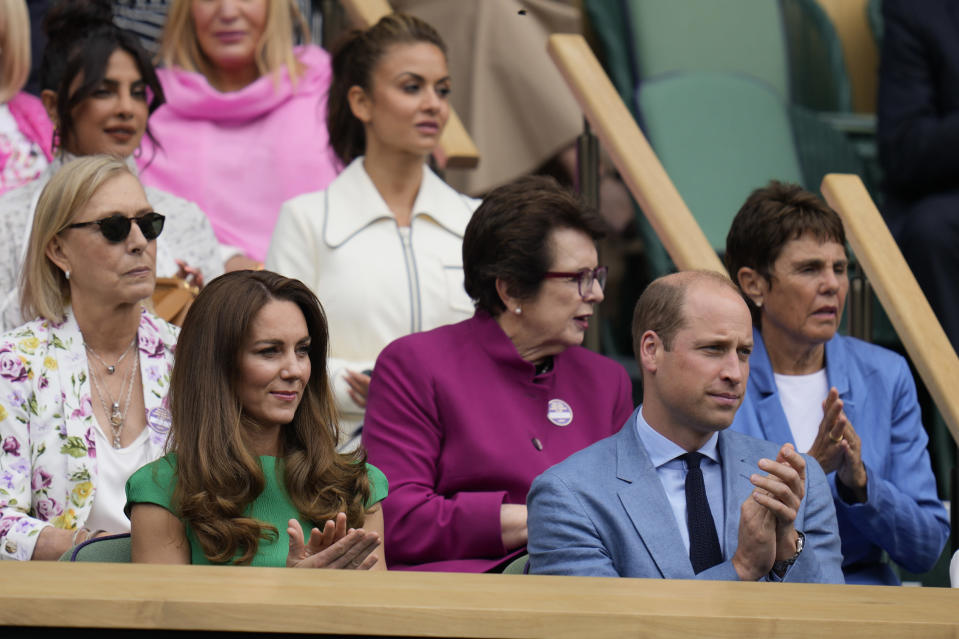 Kate, Duchess of Cambridge, left sits next to Prince William in the Royal Box ahead of the women's singles final on day twelve of the Wimbledon Tennis Championships in London, Saturday, July 10, 2021. (AP Photo/Kirsty Wigglesworth)