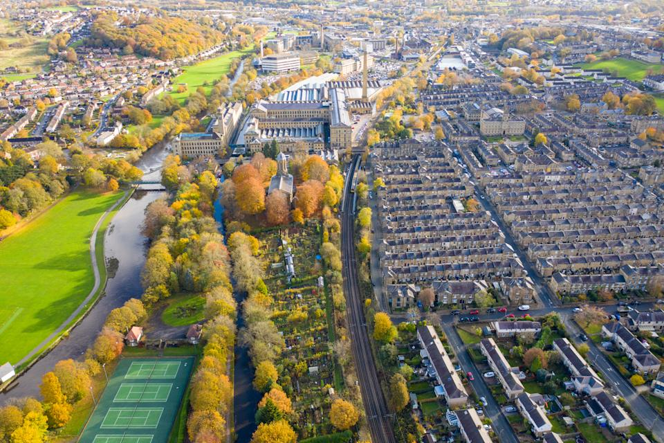 Aerial photo taken in the small town of Shipley in the City of Bradford, West Yorkshire, England showing the autumn fall colours of the hosing estates and roads in the town centre.