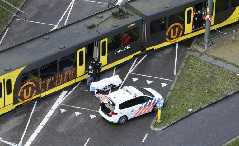 A body covered in a white sheet was seen near the tram after the shooting