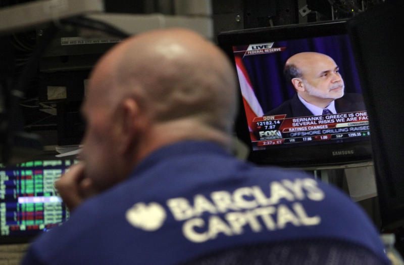Federal Reserve Chairman Ben Bernanke's news conference is seen on a television screen in a booth on the floor of the New York Stock Exchange, Wednesday, June 22, 2011, in New York. Bernanke said some of the problems that are slowing the U.S. economy could persist into next year. (AP Photo/Richard Drew)