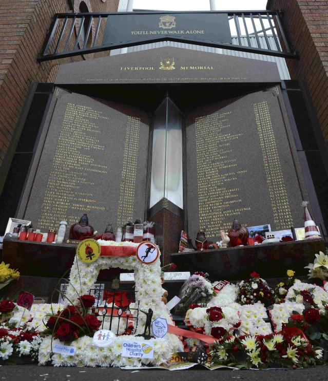 The Hillsborough memorial is seen covered in flowers ahead the English Premier League soccer match between Liverpool and Manchester City at Anfield in Liverpool, northern England April 13, 2014. REUTERS/Nigel Roddis (BRITAIN - Tags: SPORT SOCCER)