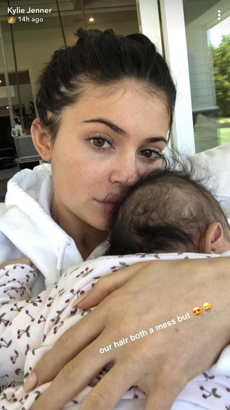 Cuddles: Kylie Jenner snuggled her two-month-old daughter (Snapchat / Kylie Jenner)