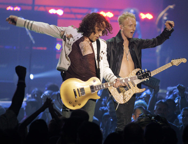 FILE - In a May 25, 2006, file photo Vivian Campbell, left, and Phil Collen, right, of rock group Def Leppard perform   in Las Vegas.  In a statement Monday, June 10, 2013, Campbell reveals he has Hodgkin's Lymphoma and has been in chemotherapy for two months, with four months to go. (AP Photo/Jae C. Hong, file)