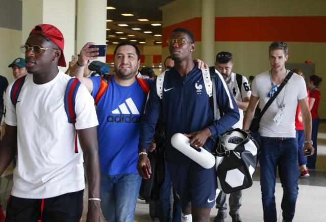 Soccer Football - World Cup - France Departure - Sheremetyevo International Airport, Moscow Region, Russia - July 16, 2018. A man takes a selfie with Paul Pogba before the departure of the team. REUTERS/Sergei Karpukhin