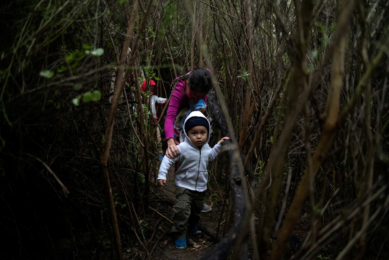 Mateo, a two-year-old boy from Honduras, is led through dense brush by his mother Juana Maria after a group of two dozen families members illegally crossed the Rio Grande river into the United States from Mexico, in Fronton, Texas, October 18, 2018.  REUTERS/Adrees Latif      TPX IMAGES OF THE DAY