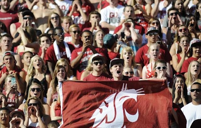 Ben Allen, a junior at Washington State, cheers on the Cougars as they take on the Southern Utah Thunderbirds before the start of an NCAA college football game, Saturday, Sept. 14, 2013, in Pullman, Wash. (AP Photo/Rajah Bose)