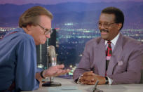 """FILE - In this Oct. 4, 1995 file photo, Defense attorney Johnnie Cochran Jr., right, sits for an interview with Larry King, the host of the """"Larry King Live"""" show in the Hollywood section of Los Angeles. King, who interviewed presidents, movie stars and ordinary Joes during a half-century in broadcasting, has died at age 87. Ora Media, the studio and network he co-founded, tweeted that King died Saturday, Jan. 23, 2021 morning at Cedars-Sinai Medical Center in Los Angeles. (AP Photo/Damian Dovarganes, File)"""