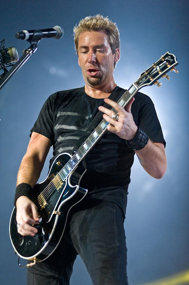 MOLINE, IL - APRIL 10:  Ryan Peake and Chad Kroeger of Nickelback perform at the I Wireless Center on April 10, 2012 in Moline, Illinois.  (Photo by Timothy Hiatt/Getty Images)