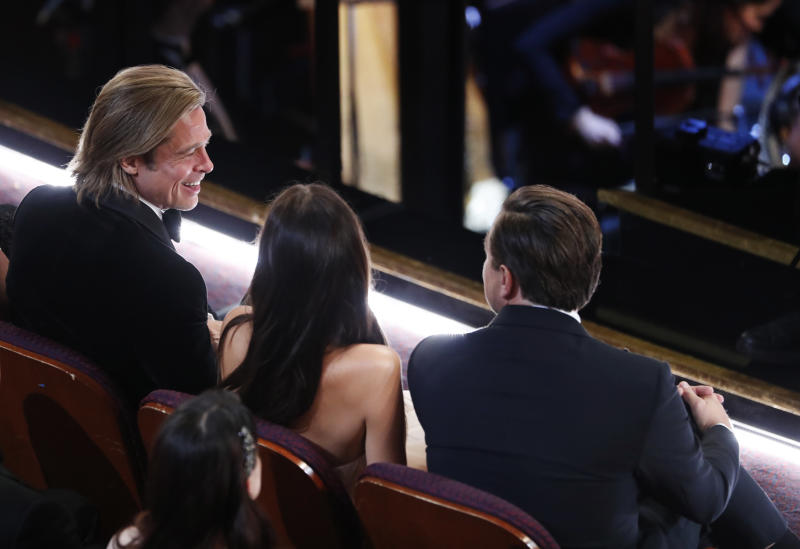 Brad Pitt, Camila Morrone and Leonardo DiCaprio attend the Oscars show at the 92nd Academy Awards in Hollywood, Los Angeles, California, U.S., February 9, 2020. REUTERS/Mario Anzuoni