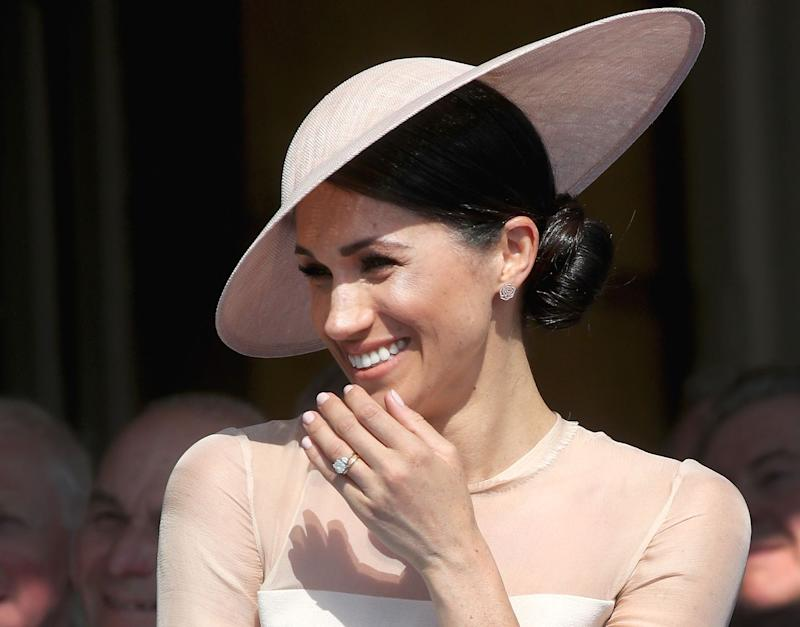 Meghan Markle and Prince Harry giggle as they enjoy private joke