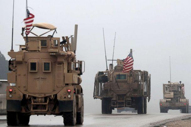 PHOTO: US military vehicles are seen in Syria's northern city of Manbij, Dec. 30, 2018. (Delil Souleiman/AFP/Getty Images)