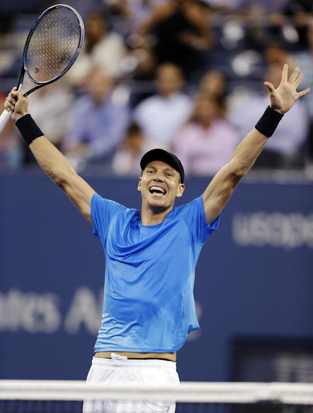 Tomas Berdych, of the Czech Republic, raises his arms after defeating Roger Federer, of Switzerland, in the quarterfinal round of play at the U.S. Open tennis tournament, Wednesday, Sept. 5, 2012. in New York. Berdych won 7-6 (1), 6-4, 3-6, 6-3. (AP Photo/Charles Krupa)