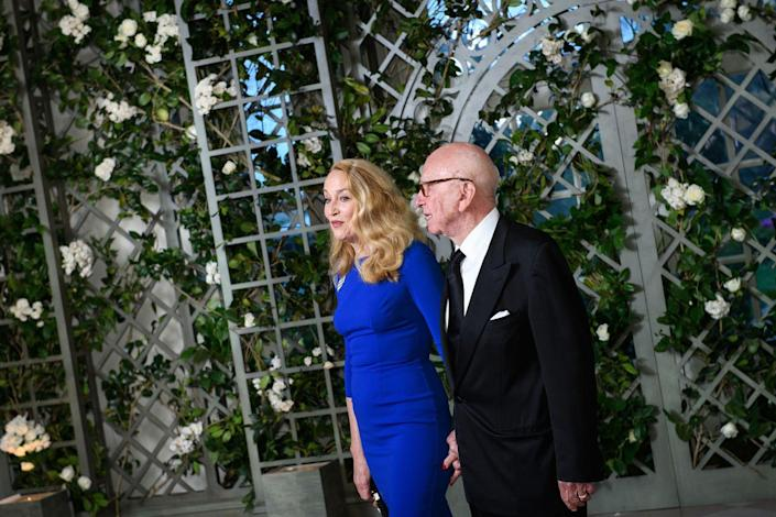 <p>The around 120 guests attending the event entered through a hall with a trellis covered in greenery and white flowers. Here, media mogul Rupert Murdoch and wife Jerry Hall arrive hand in hand.</p>