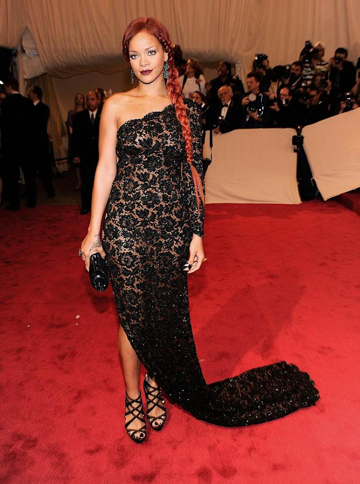 "Rihanna rocked a sheer black lace Stella McCartney gown on fashion's big night. Unfortunately, she dared to pair it with a red, ridiculously-long side-braid. Kevin Mazur/<a href=""http://www.wireimage.com"" target=""new"">WireImage.com</a> - May 2, 2011"