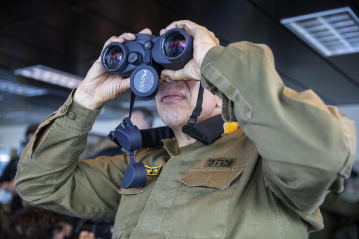 Vice Adm. Eli Sharvit looks out from aboard the Israeli Navy Ship Atzmaut in the Mediterranean Sea, Wednesday, Sept. 1, 2021. Speaking to The Associated Press days after completing his five-year term, Sharvit described Iranian activities on the high seas as a top Israeli concern and said the navy is able to strike wherever necessary to protect the country's economic and security interests. (AP Photo/Ariel Schalit)